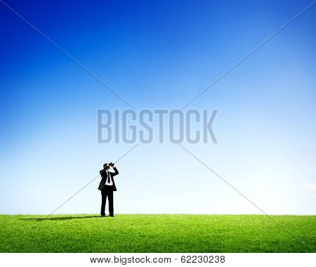 New Opportunities: Businessman Looking Through Binoculars with Blue Sky
