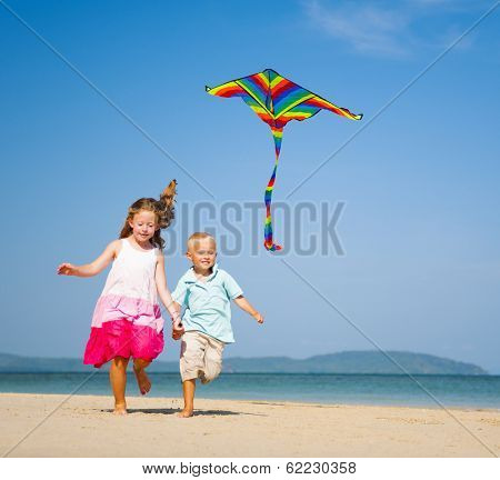 Girl and Boy Playing with Kite on a Beach