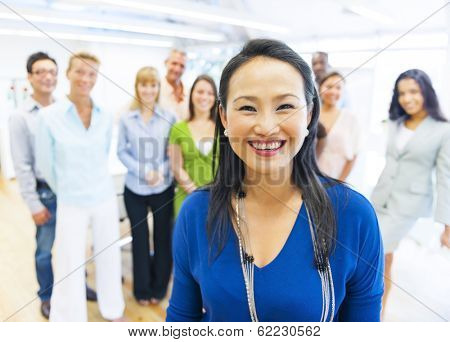 Beautiful Asian Woman In Front of Colleagues at Office