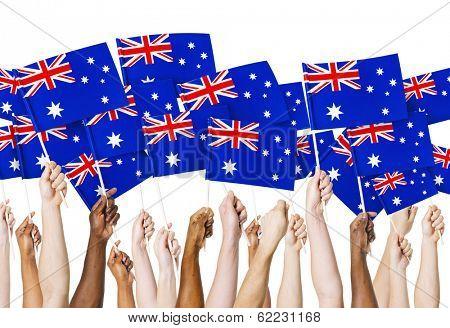 Diverse Hands Holding Australian Flags