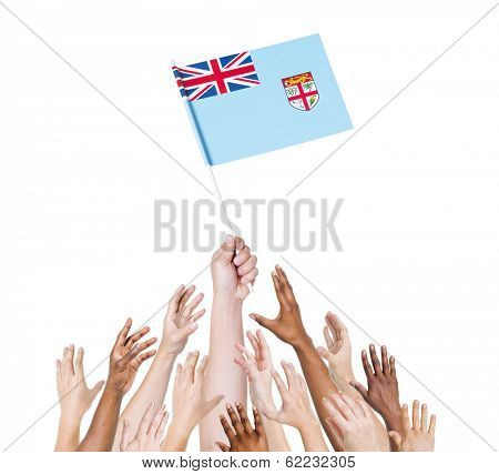 Diverse Multiethnic Hands Holding and Reaching For The Flag of Fiji