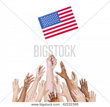 Diverse Multiethnic Hands Holding and Reaching For The Flag of United States of America