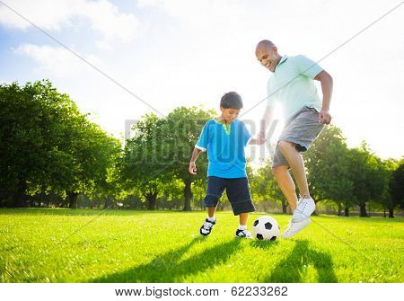 Father and Son Playing Ball in The Park