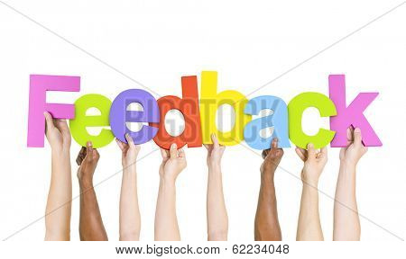 Multi Ethnic People Holding The Word Feedback