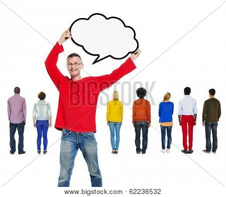 Man Standing With Speech Bubble In Front of Group of Multi-Ethnic People