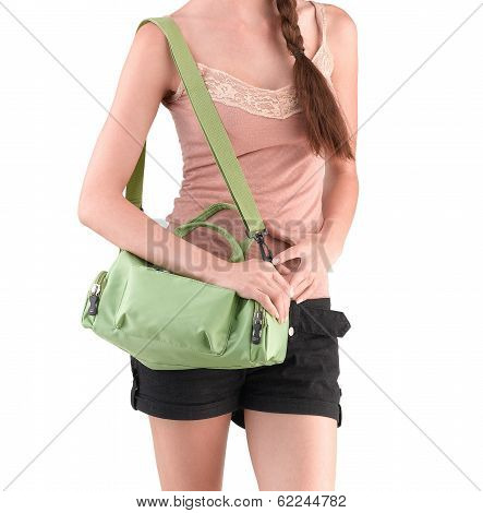 woman carrying a green canvas handbag