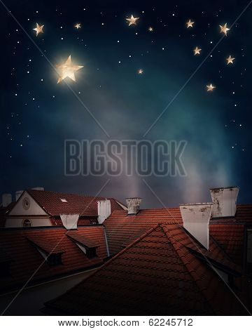 Rooftops and night sky with stars