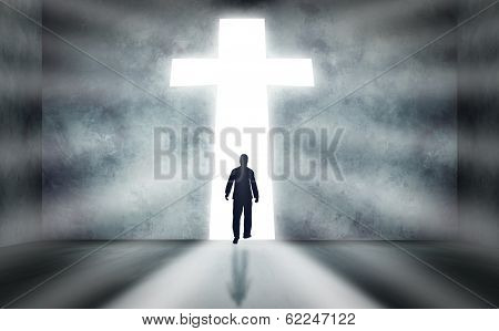 Man Walking Towards Cross