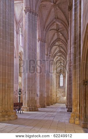 Batalha, Portugal - March 02, 2013: Batalha Monastery. Secondary nave and aisle of the Church. Gothic and Manueline masterpiece. Portugal. UNESCO World Heritage Site.