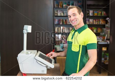 Cashier At Cash Register In Shop Or Store