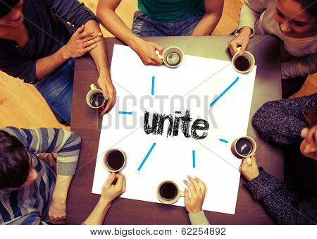 Student drinking coffee sitting around page saying the word unite