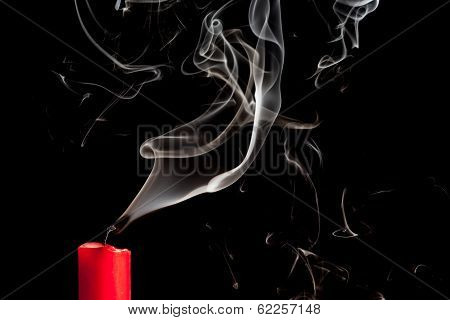 Smoke From Blown Out Red Candle