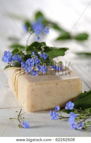 natural soap on white wooden table