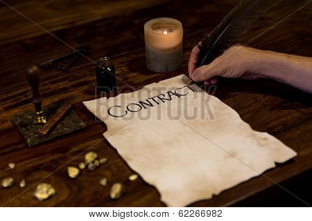 Medieval Looking Man Writes A Contract