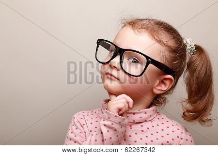 Smart Dreaming Kid Girl In Glasses Looking