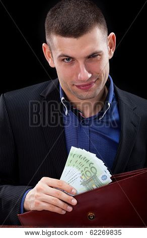 Businessman With Banknotes