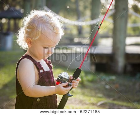 Cute Young Boy With Fishing Pole Outside at The Lake.