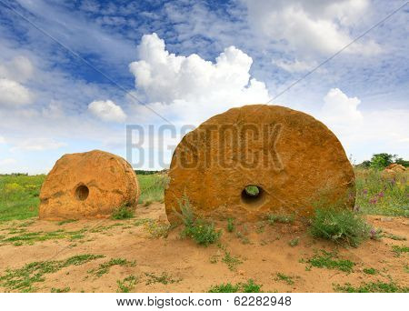 Old millstones in steppe, Ukraine