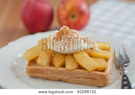 waffles with diced apple cooked and cinnamon