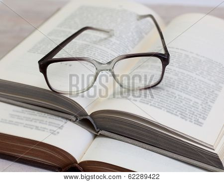 Glasses And Open Books On The Table