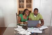 Young Ethnic Couple Paying Bills Over Internet