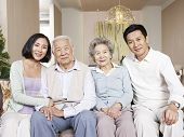 stock photo of senior class  - home portrait of a happy asian family - JPG