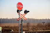stock photo of railroad-sign  - Railway level crossing with warning sign  - JPG