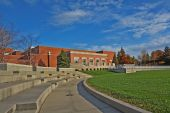 pic of school building  - Schwitzer Student Center and part of an outdoor amphitheater on the campus of the University of Indianapolis in Indiana with blue sky and white clouds - JPG