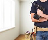 foto of blue-collar-worker  - Image of a blue collar worker with drill - JPG