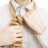 stock photo of gallows  - Businessman wearing gallows rope over his neck   - JPG