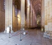 Batalha, Portugal - March 02, 2013: Batalha Monastery. Nave and Altar of the Church. Gothic and Manu