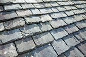 stock photo of slating  - Aged slate roof tiles close - JPG
