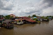 stock photo of houseboats  - houseboat and river with blue sky in Thailand - JPG