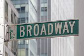 stock photo of broadway  - Roadsign of Manhattans famous Broadway with blurred background