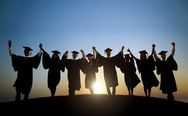 stock photo of graduation gown  - Group Of Diverse International Students Celebrating Graduation - JPG