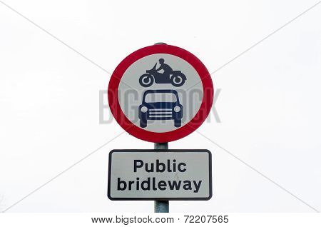 Closeup On Public Bridleway Red And White Sign Post