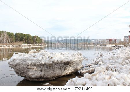 Scrapped floe on the river bank after an ice drift