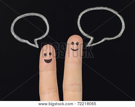 Happy fingers with chalk speech bubbles