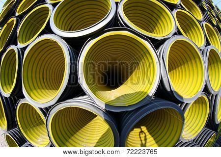 Many Yellow Corrugated Tube Photographed With Fisheye Lens