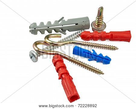 Fasteners: set of different screws, hooks, bolt and straddling dowels isolated on white
