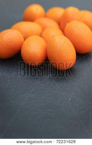 Kumquats on Dark Background.