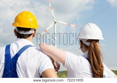Engineers Or Installers Looking At Wind Energy Turbine