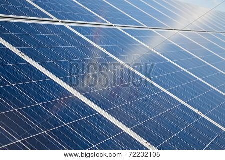 Solar Panels With Vague Reflection Of Wind Turbine