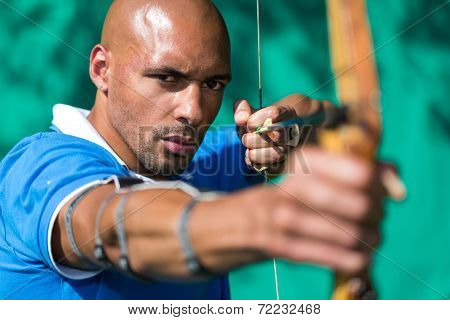 Archer Aiming At Target With Bow And Arrow