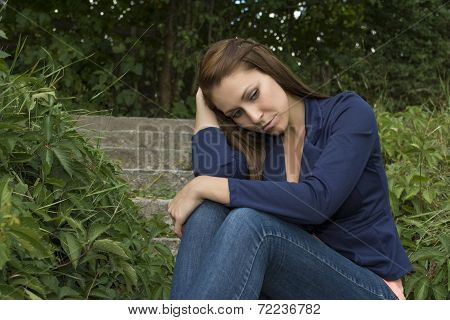 Sad Thoughtful Woman Sitting On Stairs