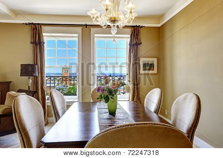 Dining Table With Flowers And City View Through The Window