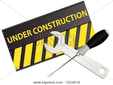 under construction sign with screwdriver and wrench