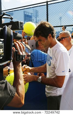 Seventeen times Grand Slam champion Roger Federer signing autographs after practice for US Open 2014