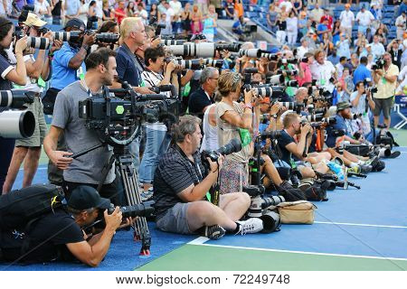 Professional photographers on tennis court during trophy presentation at the Arthur Ashe Stadium