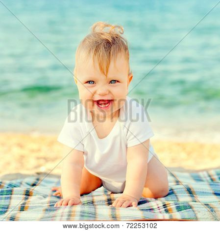 Happy Baby On The Beach At The Seaside.